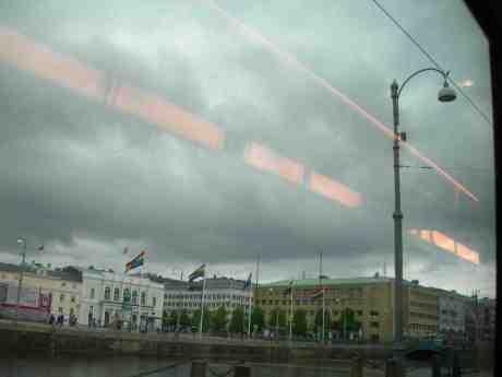 City founder Gustaf II Adolf in his pride surrounded by Rainbow flags. Från 6:ans spårvagn på Södra Hamngatan onsdag 22 maj 2013 kl 19.08.